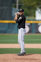 Akron RubberDucks relief pitcher Cameron Hill (10) gets ready to deliver a warmup pitch during a game against the Erie SeaWolves on August 27, 2017 at UPMC Park in Erie, Pennsylvania.  Akron defeated Erie 6-4.  (Mike Janes/Four Seam Images)
