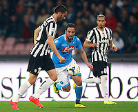 Calcio, Serie A: Napoli vs Juventus. Napoli, stadio San Paolo, 30 marzo 2014. <br /> Juventus defender Leonardo Bonucci, left, is challenged by Napoli forward Gonzalo Higuain, of Argentina, during the Italian Serie A football match between Napoli and Juventus at Naples' San Paolo stadium, 30 March 2014.<br /> UPDATE IMAGES PRESS/Isabella Bonotto