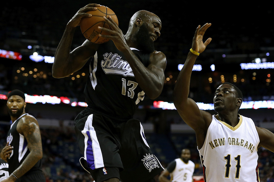 NEW ORLEANS, LA - MARCH 07:  Quincy Acy #13 of the Sacramento Kings rebounds the ball over Jrue Holiday #11 of the New Orleans Pelicans during the first half of a game at Smoothie King Center on March 7, 2016 in New Orleans, Louisiana.  (Photo by Jonathan Bachman/Getty Images) NOTE TO USER: User expressly acknowledges and agrees that, by downloading and or using this photograph, User is consenting to the terms and conditions of the Getty Images License Agreement.