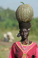 SOUTH SUDAN  Bahr al Ghazal region , Lakes State, town Rumbek , portrait of Dinka woman with pumpkin