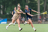 NEWTON, MA - MAY 22: Savannah Buchanan #8 of Notre Dame brings the ball forward as Cara Urbank #26 of Boston College defends during NCAA Division I Women's Lacrosse Tournament quarterfinal round game between Notre Dame and Boston College at Newton Campus Lacrosse Field on May 22, 2021 in Newton, Massachusetts.