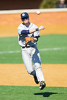 Third baseman Sean Lamont #6 of the Georgetown Hoyas makes an off-balance throw to first base against the Delaware State Hornets at Gene Hooks Field on February 26, 2011 in Winston-Salem, North Carolina.  Photo by Brian Westerholt / Four Seam Images