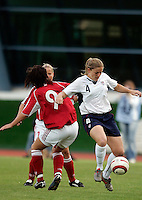 Cat Whitehill (R) traps the ball at the VRS Antonio Stadium in VRS Antonio, March 14, 2007, during the final of Algarve Women's Cup soccer match between USA and Denmark. USA won 2-0.