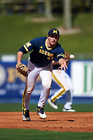 Michigan Wolverines first baseman Carmen Benedetti (43) flips the ball to the pitcher covering the bag during the second game of a doubleheader against the Canisius College Golden Griffins on February 20, 2016 at Tradition Field in St. Lucie, Florida.  Michigan defeated Canisius 3-0.  (Mike Janes/Four Seam Images)