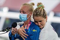 YOKOHAMA, JAPAN - AUGUST 6: Caroline Sweden #17 of Sweden hugs Lindsey Horan #9 of the USWNT at International Stadium Yokohama on August 6, 2021 in Yokohama, Japan.