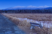 Snow-capped Northern Presidential Range just after sunset from the Presidential Range Rail Trail (Cohos Trail) at Pondicherry Wildlife Refuge in Jefferson, New Hampshire USA during the winter months.