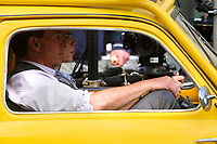 Actor Tom Cruise and actress Hayley Atwell in a yellow Fiat 500 on the set of the film Mission Impossible 7 shot in Via Nazionale.<br /> Rome (Italy), October 9th 2020<br /> Photo Samantha Zucchi Insidefoto