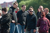 """Am Samstag den 26. April 2014 versuchte die Neonazipartei NPD in Berlin erneut einen Aufmarsch durch den Stadtteil Kreuzberg. 6.000 Menschen protestierten mit diversen Blokade dagegen und verhinderten, dass die ca 70 Neonazis weiter als 150m laufen konnten.<br /> So war nach 3 Minuten Marsch für die NPD Schluss und die Neonazis mussten zum Startpunkt am S-Bahnhof Jannowitzbruecke umdrehen. Auch wenn ueber den NPD-Lautsprecherwagen mehrfach behauptet wurde, die Demonstration sei in Kreuzberg, ist doch richtig, dass die Neonazis sich nur in Berlin-Mitte befanden.<br /> Bildmitte: Dennis Giemsch, Mitglied der Partei """"Die Rechte Dortmund"""". Giemsch zaehlt zu den als gewalttaetig eingeschaetzten sog. """"Autonomen Nationalisten"""" und soll lt. Medien Mitglied des verbotenen """"Nationalen Widerstand Dortmund"""" NWDO sein.<br /> 26.4.2014, Berlin<br /> Copyright: Christian-Ditsch.de<br /> [Inhaltsveraendernde Manipulation des Fotos nur nach ausdruecklicher Genehmigung des Fotografen. Vereinbarungen ueber Abtretung von Persoenlichkeitsrechten/Model Release der abgebildeten Person/Personen liegen nicht vor. NO MODEL RELEASE! Don't publish without copyright Christian-Ditsch.de, Veroeffentlichung nur mit Fotografennennung, sowie gegen Honorar, MwSt. und Beleg. Konto:, I N G - D i B a, IBAN DE58500105175400192269, BIC INGDDEFFXXX, Kontakt: post@christian-ditsch.de<br /> Urhebervermerk wird gemaess Paragraph 13 UHG verlangt.]"""