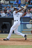 Asheville Tourists first baseman Correlle Prime #32 swings at a pitch during a game against the  Delmarva Shorebirds at McCormick Field on April 6, 2014 in Asheville, North Carolina. The Shorebirds defeated the Tourists 4-2. (Tony Farlow/Four Seam Images)