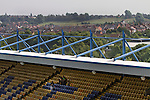 Mansfield Town Football Club Open Day, 14/07/2013. Field Mill stadium, League Two. Supporters of Mansfield Town sitting in one of the stands at Field Mill stadium during an open day held for the club's supporters. Mansfield Town achieved promotion back to England's Football League by winning the Conference National in season 2012-13. Field Mill was the oldest ground in the Football League, hosting football since 1861 although some reports date it back as far as 1850, with Mansfield Town having played there since 1919. Photo by Colin McPherson.