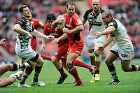 Charlie Hodgson of Saracens looks for a way through Rob Buchanan (right) and Rory Clegg of Harlequins during the Aviva Premiership match between Saracens and Harlequins at Wembley Stadium on Saturday 31st March 2012 (Photo by Rob Munro)