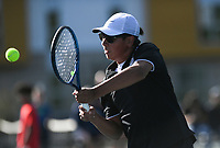 Bentonville's Santiago Aguirre hits, Monday, October 11, 2021 during the 6A state girls and boys tennis tournament at Memorial Park in Bentonville. Check out nwaonline.com/211012Daily/ for today's photo gallery. <br /> (NWA Democrat-Gazette/Charlie Kaijo)