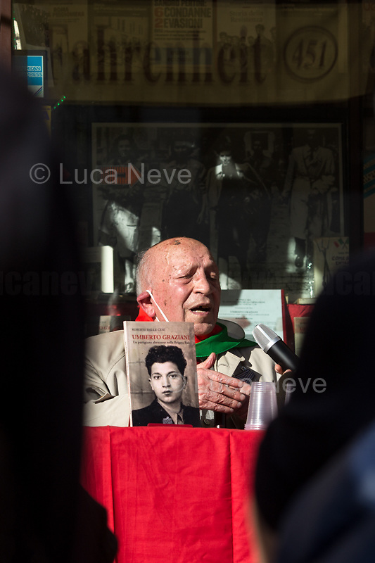 """Umberto Graziani, Partizan. <br /> <br /> Rome, Italy. 25th Apr, 2021. Today, to mark the 76th Anniversary of the Italian Liberation from nazi-fascism the Fahrenheit 451 Bookshop (Libreria Fahrenheit 451, Piazza Campo De' Fiori 44, Rome, 1.), co-organised with ANPI Roma Centro (National Association of WWII Italian Partizans, 2.) the presentation of the book """"Umberto Graziani Un Partigiano Abruzzese Nella Brigata Rab"""" (Umberto Graziani A Partizan From Abruzzo In The Rab Brigade, D'Abruzzo Edizioni Menabò, 3.) written by Roberto Delle Cese. The event was hosted by the author of the book who held a public conversation with the Partizan Umberto Graziani. From the Facebook event page (4.): «[…] With an original and authentic language, the memories of the partisan Umberto Graziani (born in 1923), originally from Vestea, a fraction of the municipality of Civitella Casanova in the province of Pescara, a detailed account of the fascist internment camp of Kampor, on the island of Arbe in Croatia and the events linked to the Yugoslav Resistance in which Italian partisans also participated. In the testimony Graziani recounts the years of his youth in Abruzzo, focusing on the circumstances that led him to mature the choice to become a partisan. The decision to fight for a better future, characterized by the ideals of justice and freedom, was the result of a political conscience matured as a boy during fascism and subsequently developed during the war period. On the basis of an extensive bibliography, the introductions by Gianni Orecchioni and the author place Graziani's memoirs in the complex context of the years 1941-44 in the region of the former Yugoslavia […]».<br /> <br /> Footnotes & Links:<br /> 1. http://bit.do/fQC9r<br /> 2. http://bit.do/fQC9v<br /> 3. http://bit.do/fQC6v<br /> 4. http://bit.do/fQC9y<br /> Related Stories:<br /> - 25 April 21 - A Centocelle Per La Liberazione: http://bit.do/fQC6E<br /> - I Partigiani http://tiny.cc/cwi3nz"""