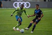 SAN JOSE, CA - OCTOBER 18: Cristian Espinoza #10 of the San Jose Earthquakes evades Nouhou Tolo #5 of the Seattle Sounders during a game between Seattle Sounders FC and San Jose Earthquakes at Earthquakes Stadium on October 18, 2020 in San Jose, California.