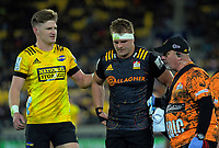 Jordie Barrett checks on the injured Sam Cane during the Super Rugby Aotearoa match between the Hurricanes and Chiefs at Sky Stadium in Wellington, New Zealand on Saturday, 8 August 2020. Photo: Dave Lintott / lintottphoto.co.nz