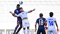 GUADALAJARA, MEXICO - MARCH 28: Andres Perea #15 of the United States and  Juan Carlos Obregon #9 of Honduras battle during a game between Honduras and USMNT U-23 at Estadio Jalisco on March 28, 2021 in Guadalajara, Mexico.