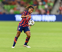 AUSTIN, TX - JUNE 16: Catarina Macario #11 of the United States gains control of a loose ball during a game between Nigeria and USWNT at Q2 Stadium on June 16, 2021 in Austin, Texas.