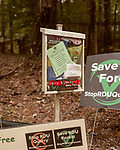 October 8, 2019. Cary, North Carolina.<br /> <br /> A home along Old Reedy Creek Road has stocks of anti-quarry expansion signs available for the taking. Old Reedy Creek Road runs between two plots of land owned by RDU Airport and ends at Umstead State Park. The tract on the right hand side of the road is adjacent the current quarry and is proposed for the expansion and is popular with runner, walkers and bike riders. <br /> <br /> The proposed expansion of a Wake Stone Corp. granite aggregate quarry onto land owned by the Raleigh-Durham International Airport, which also borders Umstead State Park, has ignited a debate about what to do with unused public land and brought to the surface the conflict between recreation and the residential growth of the area. <br /> <br /> Jeremy M. Lange for The Wall Street Journal