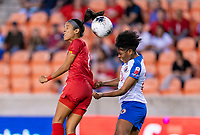 HOUSTON, TX - FEBRUARY 3: Amarelis De Mera #9 of Panama goes up for a header with Kethna Louis #20 of Haiti during a game between Panama and Haiti at BBVA Stadium on February 3, 2020 in Houston, Texas.