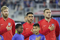 WASHINGTON, D.C. - OCTOBER 11: Tim Ream #13, Cristian Roldan #15 and Jordan Morris #11 of the United States during the national anthem prior to their Nations League game versus Cuba at Audi Field, on October 11, 2019 in Washington D.C.