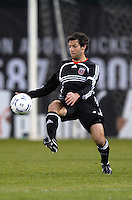 DC United midfielder Ben Olsen (14) traps the ball. DC United defeated CD Olimpia 3-2 to advance to the semi finals of the CONCACAF Champions' Cup. March 1, 2007 at RFK Stadium in Washington DC.