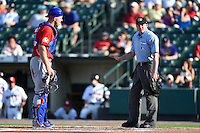 Umpire Joseph Born explains a call to catcher Erik Kratz (39) during the second game of a doubleheader between the Buffalo Bisons Rochester Red Wings on July 6, 2014 at Frontier Field in Rochester, New  York.  Rochester defeated Buffalo 6-1.  (Mike Janes/Four Seam Images)