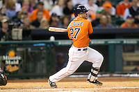 Houston Astros second baseman Jose Altuve (27) follows through on his swing during the MLB baseball game against the Detroit Tigers on May 3, 2013 at Minute Maid Park in Houston, Texas. Detroit defeated Houston 4-3. (Andrew Woolley/Four Seam Images).