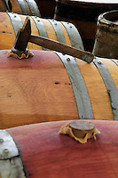 wooden bung with jute on barrel hammer tool domaine gachot-monot nuits-st-georges cote de nuits burgundy france