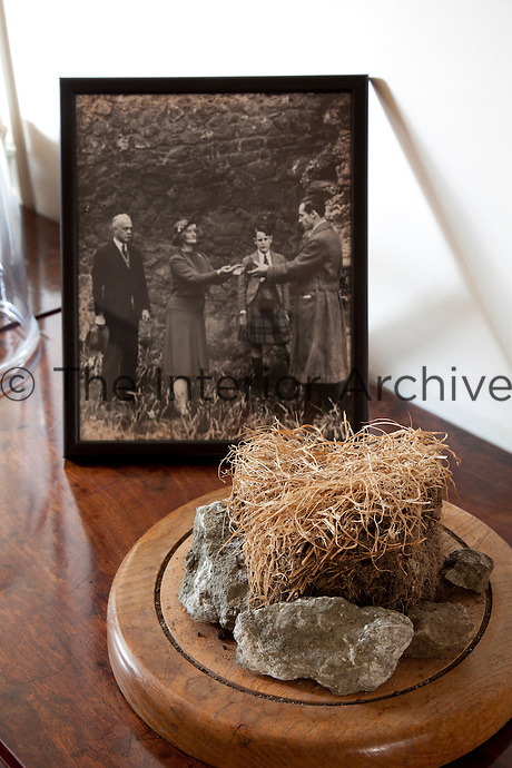 Clod of earth symbolising the family's gift of the house to the National Trust for Scotland. Accompanying photo of the 1946 ceremony with Eleanor Dalyell and young Tam in the background