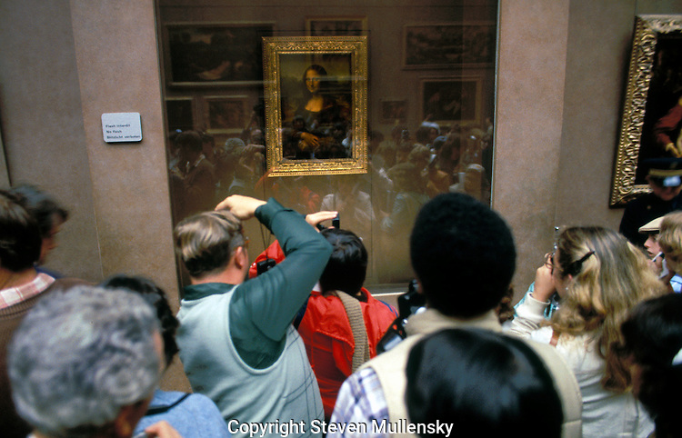 March 1980: Visitors to the Louvre in Paris, France jostle for a view of the Mona Lisa.