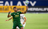 CARSON, CA - OCTOBER 07: Jeremy Ebobisse #17 of the Portland Timbers eyes the ball over Emiliano Insua #3 of the Los Angeles Galaxy during a game between Portland Timbers and Los Angeles Galaxy at Dignity Heath Sports Park on October 07, 2020 in Carson, California.