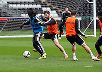 Wednesday, 23 April 2014<br /> Pictured L-R: Marvin Emnes against Jordi Amat. <br /> Re: Swansea City FC are holding an open training session for their supporters at the Liberty Stadium, south Wales,