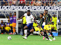 DALLAS, TX - JULY 25: Daryl Dike #11 of the United States and Devon Williams #22 of Jamaica chase after a loose ball during a game between Jamaica and USMNT at AT&T Stadium on July 25, 2021 in Dallas, Texas.