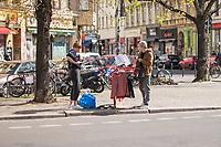 """Alltag in Berlin waehrend der Corona-Krise am 16. April 2020.<br /> Im Bild: Menschen befuellen in Berlin-Kreuzberg einen  sog. """"Gabenzaun fuer Obdachlose"""" mit Bekleidung und Lebensmitteln.<br /> 16.4.2020, Berlin<br /> Copyright: Christian-Ditsch.de<br /> [NUR FUER REDAKTIONELLE ZWECKE! Werbung nur auf Anfrage beim Fotografen. Inhaltsveraendernde Manipulation des Fotos nur nach ausdruecklicher Genehmigung des Fotografen. Vereinbarungen ueber Abtretung von Persoenlichkeitsrechten/Model Release der abgebildeten Person/Personen liegen nicht vor. NO MODEL RELEASE! Don't publish without copyright Christian-Ditsch.de, Veroeffentlichung nur mit Fotografennennung, sowie gegen Honorar, MwSt. und Beleg. Konto: I N G - D i B a, IBAN DE58500105175400192269, BIC INGDDEFFXXX, Kontakt: post@christian-ditsch.de<br /> Bei der Bearbeitung der Dateiinformationen darf die Urheberkennzeichnung in den EXIF- und  IPTC-Daten nicht entfernt werden, diese sind in digitalen Medien nach §95c UrhG rechtlich geschuetzt. Der Urhebervermerk wird gemaess §13 UrhG verlangt.]"""