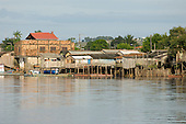 Altamira, Brazil. Wooden stilt houses beside the river in a poor part of town.