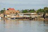 Altamira, Brazil. Wooden stilt houses beside the river in a poor part of town.