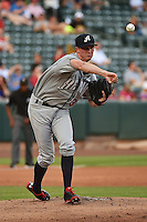 Charles Brewer (35) of the Reno Aces makes a pickoff throw to first base against the Salt Lake Bees at Smith's Ballpark on July 23, 2014 in Salt Lake City, Utah.  (Stephen Smith/Four Seam Images)