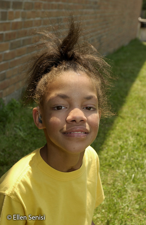 MR / Guilderland, NY / Westmere Elementary Schl.Albany Co. BOCES Deaf & Hard of Hearing Class.Girl: 12, African-American, Fetal Alcohol Syndrome, Hard of Hearing; uses hearing aid; learning American Sign Language.well-cared for in adoptive family situation.MR: Sta3.©Ellen B. Senisi