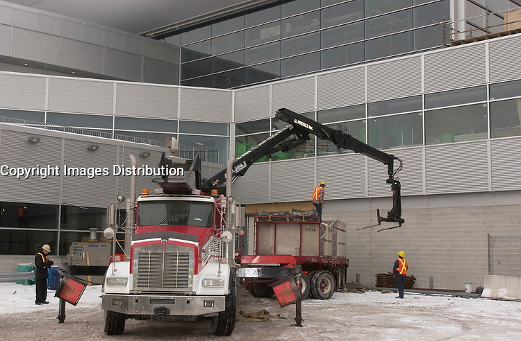 contruction of a new section at Trudeau-Montreal International Airport (YUL) formely known as Dorval Airport.<br /> <br /> Construction de la nouvelle jetee de l'Aeroport Pierre Trudeau - Montreal <br /> <br /> photo : (c)  Images Distribution<br /> <br /> The new international jetty construction site at Montréal-<br /> Pierre Elliott Trudeau International Airport (YUL) in February 2004.<br /> <br /> Contruction de la nouvelle jetée de l'aéroport Pierre E Trudeau (YUL) Février 2004<br /> photo : (c) images Distribution