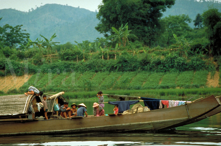 A Vietnamese family travels the Song Huong River south of Hue in central Vietnam. Average income is $200 per year for a Vietnamese family. Vietnamese family. Hue, Vietnam.
