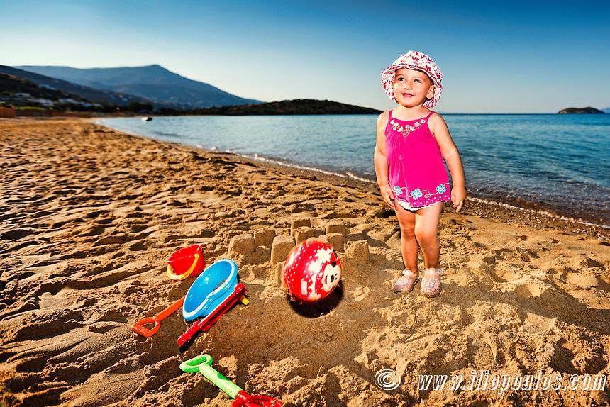 A pretty little girl having fun at the beach