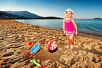 A pretty little girl having fun at the beach