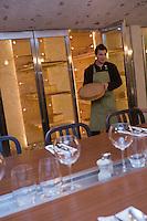 Europe/France/73/Savoie/Val d'Isère: Thomas Le Guillou sommelier  dans la cave à fromage du restaurant: La Cave à Vin de la Fruitière