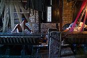 Md. Parves and Md. Naim are the few muslim weavers using traditional looms to weave famous Benaresi saris in their workspace in Gazi Sadullahpura Bade Bazaar in Varanasi in Uttar Pradesh, India. Photograph: Sanjit Das/Panos