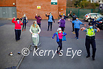 Garda Mary Gardiner and the staff of the Tralee Community Nursing Unit doing the Jerusalema dance challenge on Tuesday. Front l to r: Theresa Grimes, Amy O'Rourke and Garda Mary Gardiner. Back l to r: Doreen Mannix, Marisse Lyons, Monica O'Sullivan, Joanne Breen, Annette Spring, Siobhan O'Rourke, Paudi Sexton, Girish Nair, Maureen Millburn