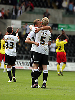 ATTENTION SPORTS PICTURE DESK<br /> Pictured L-R: Lee Trundle of Swansea, recently signed from Bristol City, hugs team mate Alan Tate after the end of the game.<br /> Re: Coca Cola Championship Swansea City Football Club v Watford at the Liberty Stadium, Swansea, south Wales. Saturday 29 August 2009<br /> Picture by D Legakis Photography / Athena Picture Agency, 24 Belgrave Court, Swansea, SA1 4PY, 07815441513