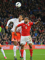 Ashley Williams of Wales (R) heads the ball away from Virgil van Dijk of Netherlands (L) during the Wales v Netherlands  International Friendly, at Cardiff City Stadium, Cardiff, Wales, United Kingdom, 13 November 2015.