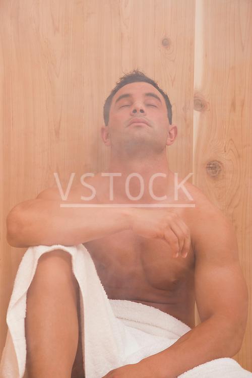 USA, Illinois, Metamora, Man relaxing in sauna