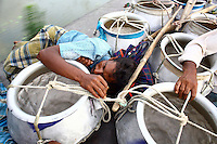 Fishermen, on their journey from market in Dhaka, sleep on the train roof among their empty fish pots. They hope to avoid the 60 taka (£0.55GBP) fare by using the roof and since they can only earn a maximum of 120 taka (£1.10GBP) from their fish the saving is vital. For others, the fares are too high and can be avoided or reduced by travelling on the roof. However, this practice also leads to regular accidents, many of them fatal..