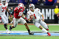 Indianapolis, IN - December 7, 2019: Ohio State Buckeyes quarterback Justin Fields (1) runs the ball during the Big Ten championship game Wisconsin and Ohio St. at Lucas Oil Stadium in Indianapolis, IN.   (Photo by Elliott Brown/Media Images International)